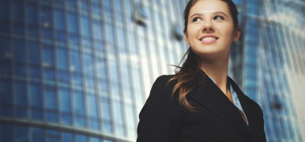 portrait-young-smiling-business-woman_53419-8303